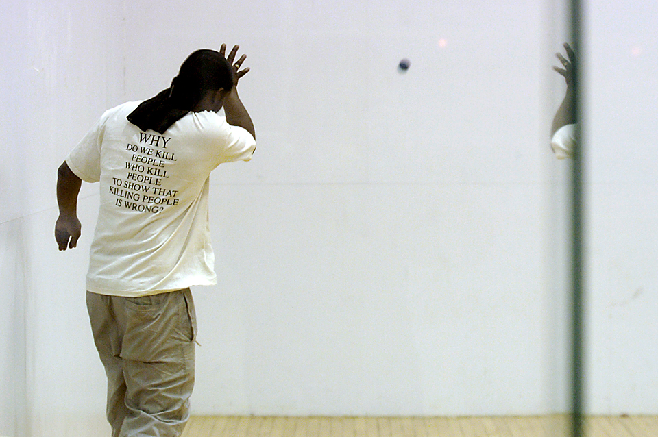 Amrine wears one of his favorite T-shirts while playing handball with friends.