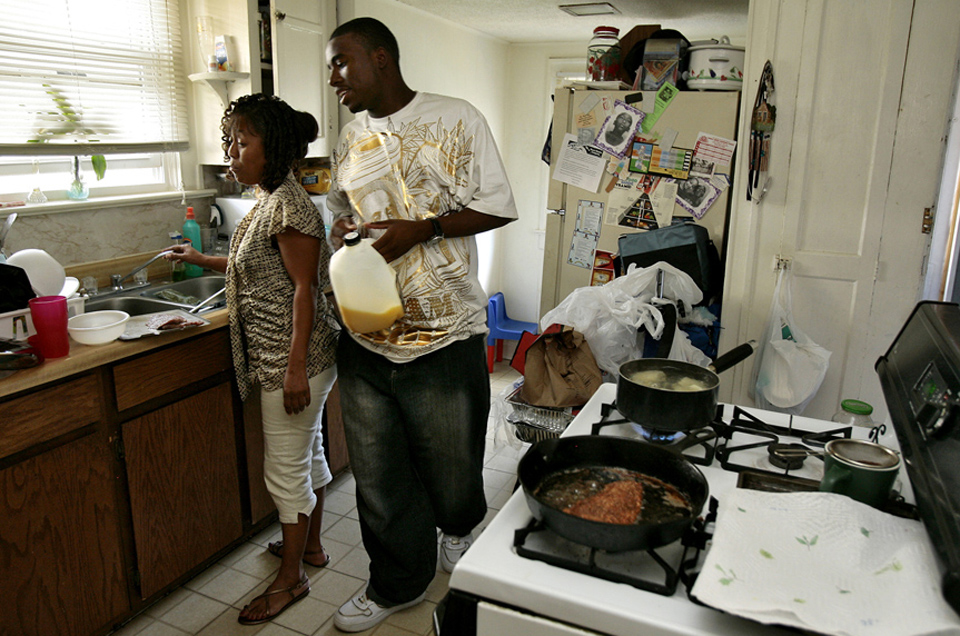 Arshell Avery encourages her son, Markese Gunnels, 16, an Urban Ranger, to help cook dinner, which he eventually did.  Avery said she knows that peer pressure and the negative influences of the streets can make it rough for kids growing up in 64130.