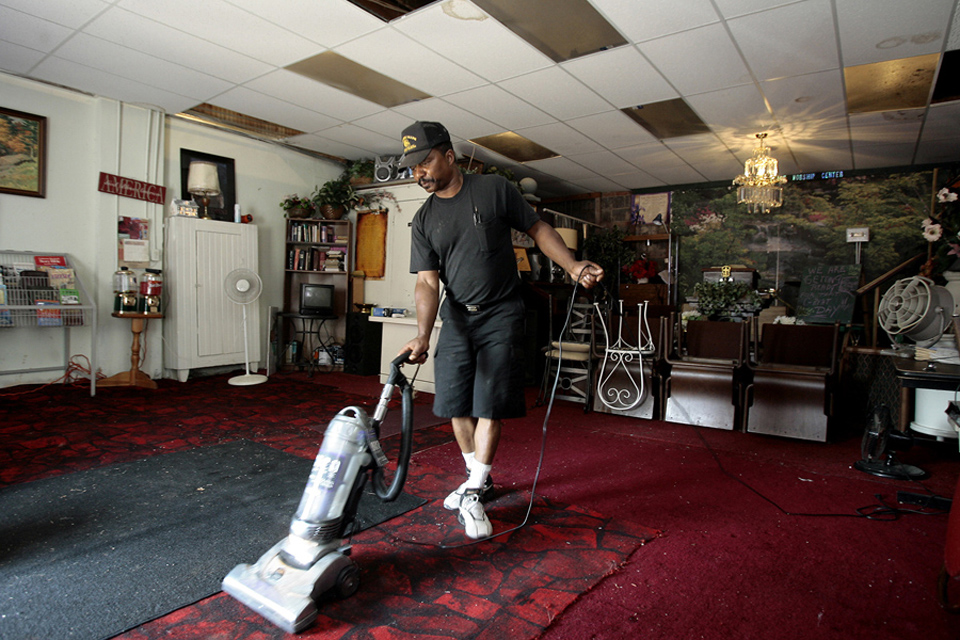 Ron Birmingham of Grandview cleans up the church he started up four years ago, A Special Place Family Worship Center, on 50th Street and Michigan Avenue.  Birmingham said he decided to start his church here in an effort to take back the neighborhood from criminal elements.