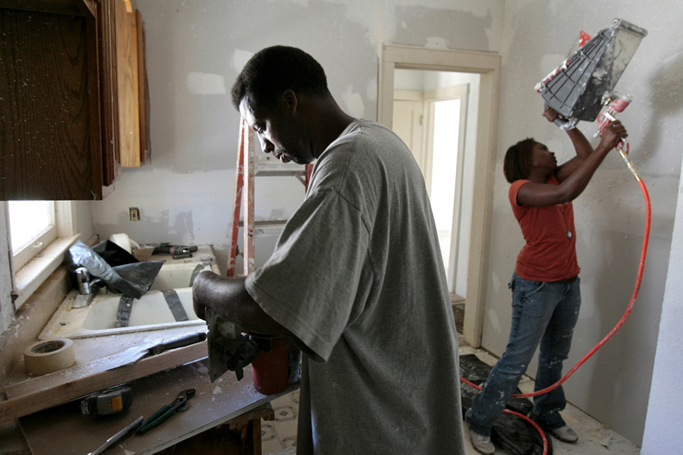 Mark Looney and fiancee Tenesia Sanders work on a house on 55th Street.  Looney served time in prison for assault.  His son was murdered at 17.  He could not find work as a felon so he used the skills he learned to rehab homes as his own boss.  He makes the homes available to people with bad credit and he also pays kids for helping out on weekends and teaches them skills.
