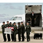 The Army Honor Guard from Fort Leavenworth transfers the of remains of Sgt. Aaron Smith of the 2nd Battalion, 87th Infantry Regiment out of Fort Drum, NY from the plane. Smith was killed in Afghanistan.