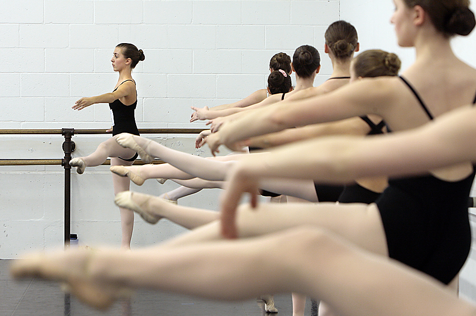 Megan McWilliams of Kansas City, 14, and other dancers work at the barre during a 2009 audition for one of 200 spots in the School of American Ballet's five-week summer program.