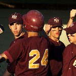 Teammates congratulate Wayne Hills High designated hitter John Ferreralla after his run in the ninth inning broke the tie (4-3).
