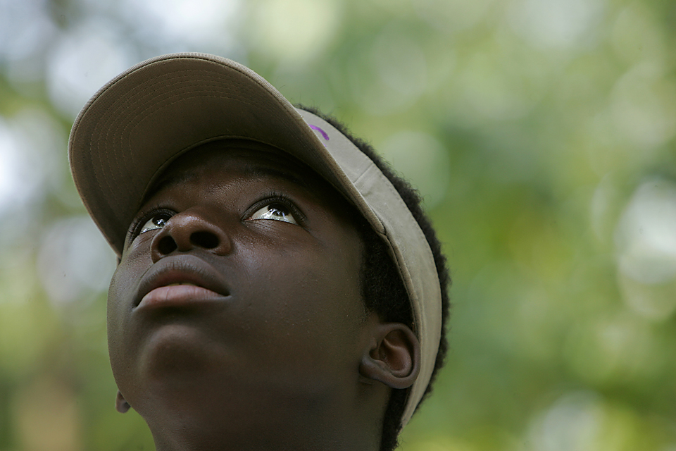 At summer camp, Wardell Williams, 14, watches as someone prepares to ride the zip line. Wardell, who has a fear of heights, eventually overcame that fear and earned numerous high-fives.