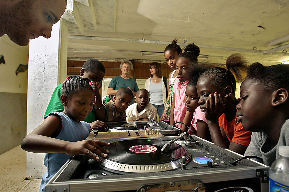 At Hip Hop Academy, Anya Davis of Kansas City, Kan., 6, and other kids learn how to scratch from DJ Nik Yady Clarke.