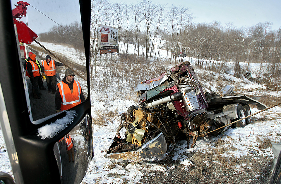 A truck carrying soda and a tanker truck containing milk were involved in an accident that resulted in the milk truck rolling down a 40-foot embankment on southbound I-29 near Dearborn, Missouri, in February 2010.