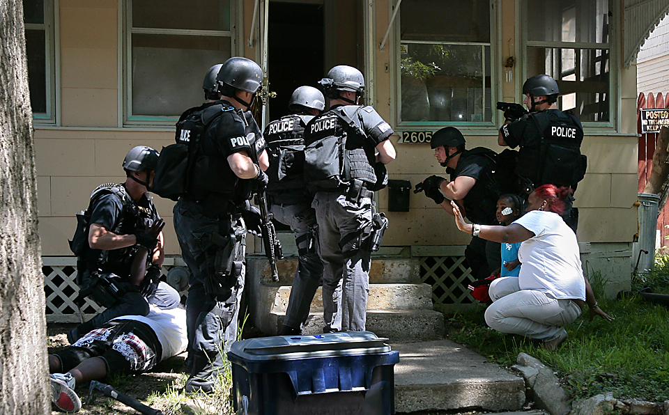 Police dedicated more than 100 officers to address a spike in violent crime in Kansas City, Missouri.  Officers with warrants searched the car and home of a woman observed acting consistent with narcotics-related activities. She and others at the house were detained and released.