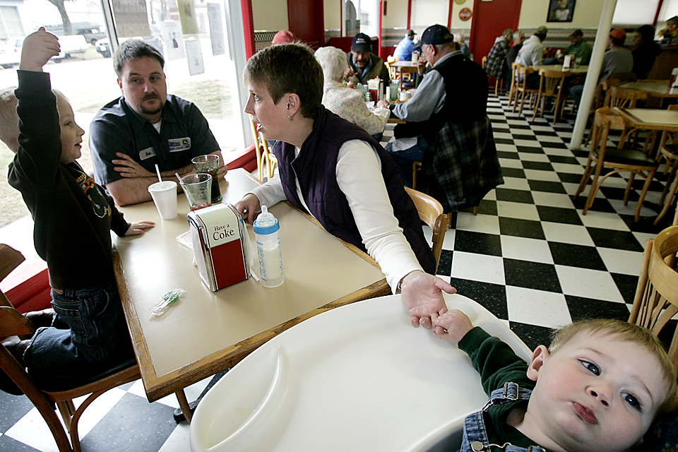 "The Bates family joins the lunch rush at Happy Days Diner in Lincoln, Kansas.  Dan and Traci Bates grew up in small nearby towns and after college, moved to metro Kansas City for work.  They returned to live in Lincoln after more than a decade in the 'big city.""  Several years ago, small towns in Kansas began offering free land as a way to attract new families to their communities."