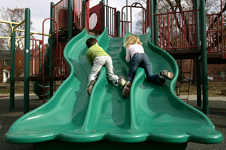 Bored with going down the big green slide the normal way, Benjamin Snyder and his stepsister Alexis Jobe decided to go backwards down the raised divider part of the slide.