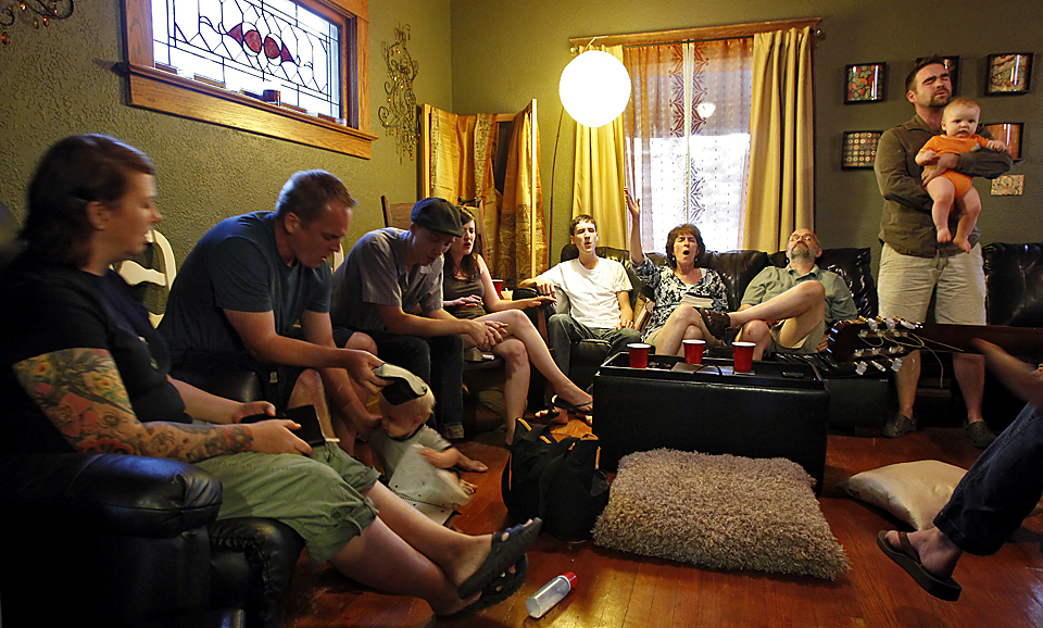 Members of the ROCK church in Northeast Kansas City have a potluck and worship at different members' homes for house church.  Young people from the suburbs have been moving into the Lykins neighborhood over the years with a strong commitment to its improvement through sustainability and community involvement, while taking advantage of low housing costs.