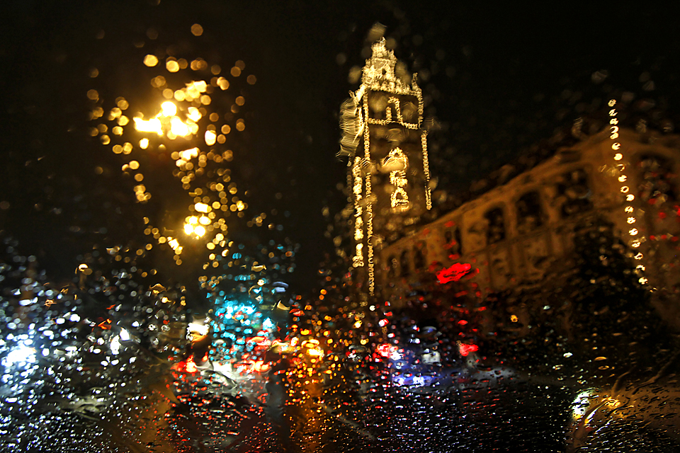 Kansas City's Country Club Plaza Lights can be seen through rain-speckled windshield glass on a drizzly Friday evening.