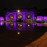 Illuminated for Breast Cancer Awareness Month, Kansas City's Union Station is reflected in the fountain.