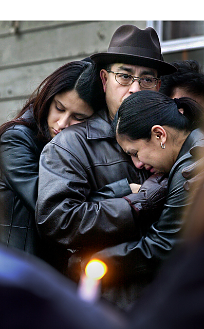 Olivia Raya and Anthony Rios were found shot in the home they shared just before Christmas. Raya's sisters Raquel and Sara, and father, Louis, comfort each other at a vigil.