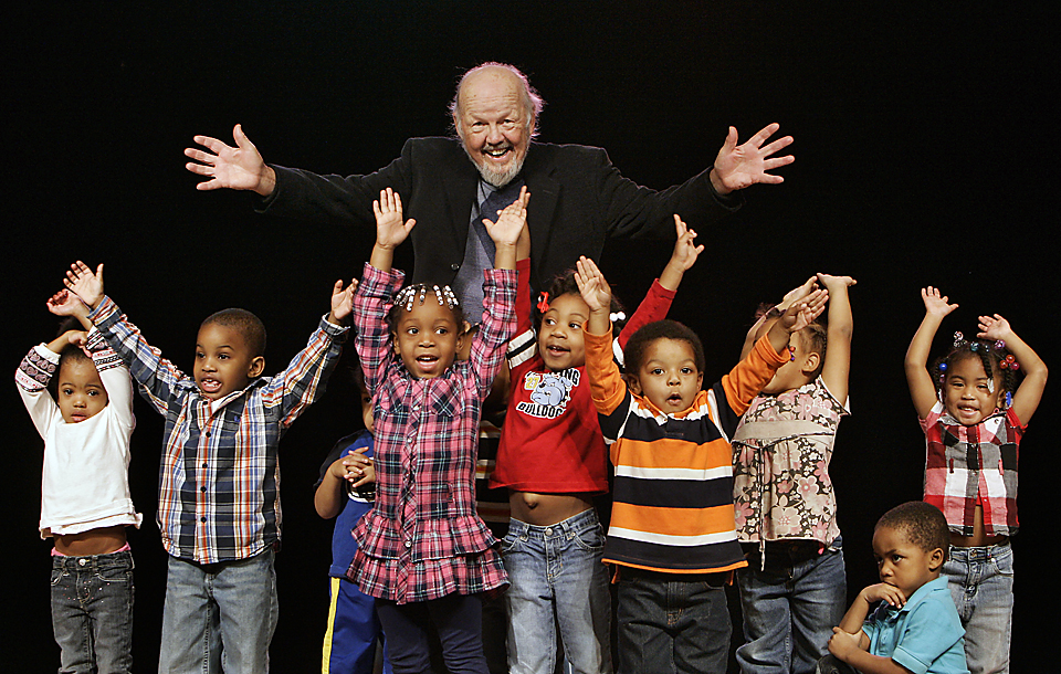 Rev. Sam Mann recently retired after about 40 years as pastor of St. Mark Union Church.  He's photographed with 3-year-olds from the St. Mark Child & Family Development Center.
