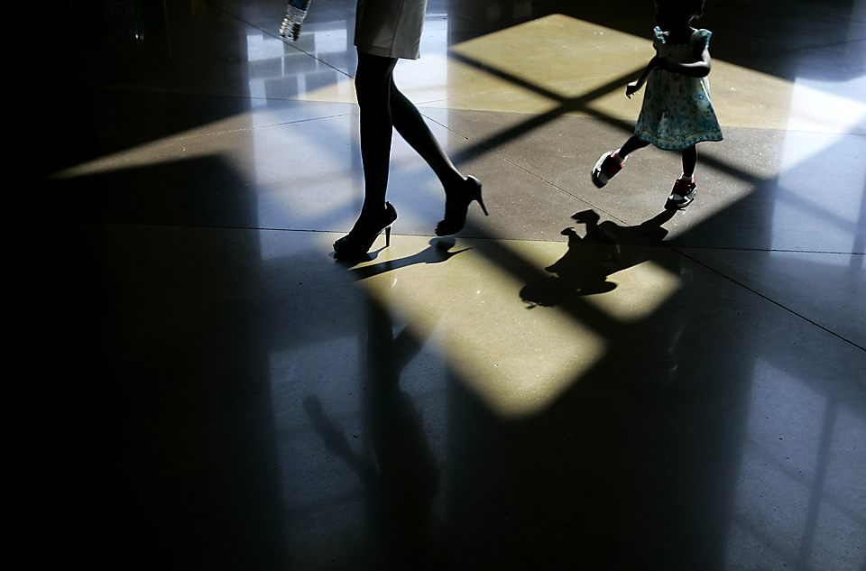 A woman and a girl as they stepped into the light at a memorial service for former NBA player and humanitarian Manute Bol.