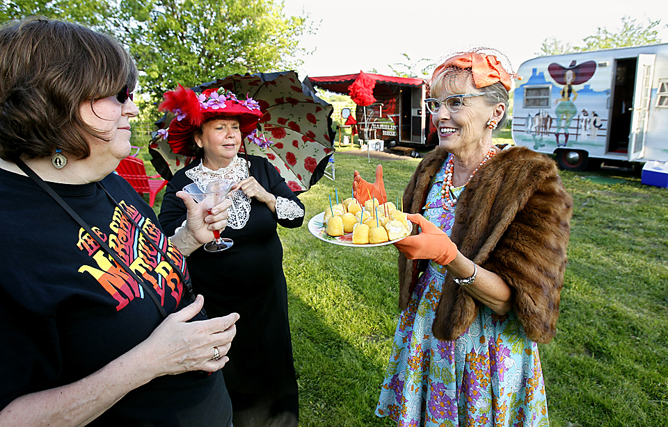 The SMOKAN chapter (Sisters in Missouri and Kansas) camped at one sister's farm in Louisburg in 2012.  After the beers and cowboy hats, some Sisters, including Pam Willcott (from right) and Helen Elston emerged from their campers in fancy period dress.