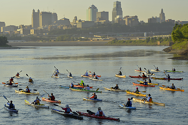 Racers in the individual event of the Missouri 340 River Race to St. Charles leave from Kaw Point in Kansas City, Kan.,  July 23, 2013 and paddle toward Kansas City, Missouri.  The Lewis and Clark expedition camped for three days at Kaw Point, where the Kansas and Missouri Rivers converge.